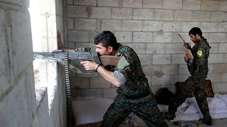 FILE PHOTO: A Kurdish fighter from the People's Protection Units (YPG). © Goran Tomasevic