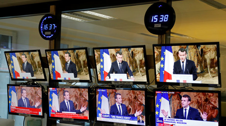TV screens seen in a newsroom show French President Emmanuel Macron delivering his New Year wishes to members of the diplomatic corps at the Elysee Palace in Paris, France, January 4, 2018. REUTERS/Charles Platiau