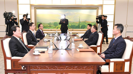 Head of North Korean delegation Jon Jong Su talks with his South Korean counterpart Chun Hae-sung January 17, 2018.