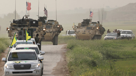 FILE PHOTO: Kurdish fighters from the People's Protection Units (YPG) head a convoy of U.S military vehicles in the town of Darbasiya next to the Turkish border © Rodi Said