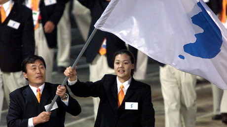 FILE PHOTO: North Korea's Jang Choo Pak (L) and South Korea's Eun-Soon Chung carry a flag bearing the unification symbol of the Korean peninsula during the opening ceremony of the Sydney 2000 Olympic Games, in Sydney, Australia © Andy Clark