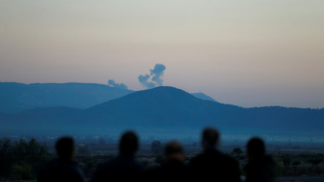 Smoke rises from the Syria's Afrin region, as it is pictured from near the Turkish town of Hassa, on the Turkish-Syrian border in Hatay province, Turkey January 20, 2018. Osman Orsal