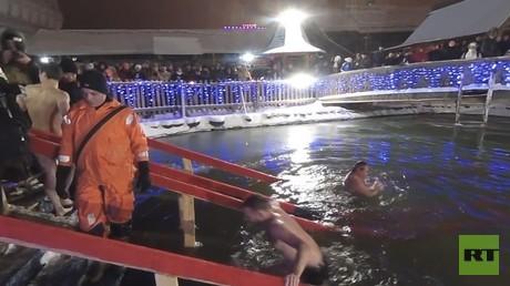Washing away sins: Ice-cold Epiphany dip (360 VIDEO)