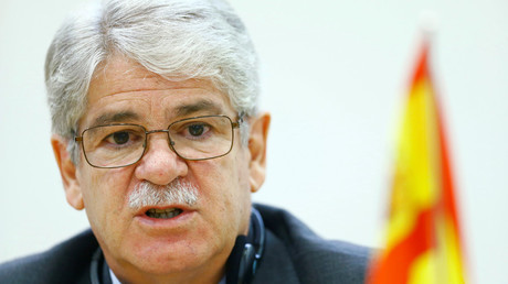 Spain's foreign minister falls ill during Davos debate (VIDEO)