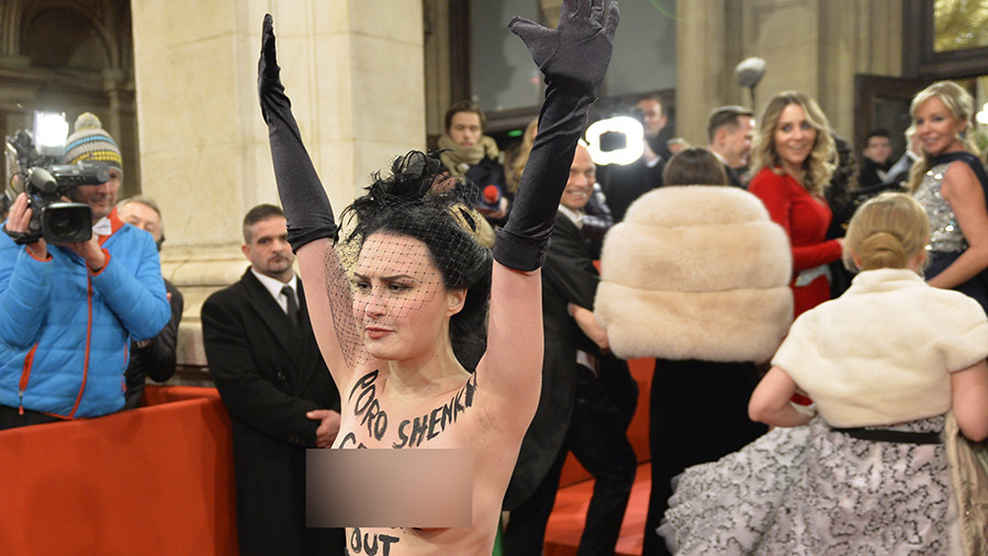 Topless 'sextremist' sends 'get the f**k out' message to Ukrainian leader at Vienna ball (PHOTOS)