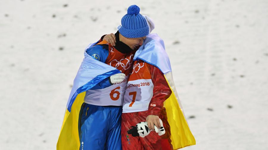 Olympic spirit: Ukrainian & Russian athletes embrace on Olympic podium