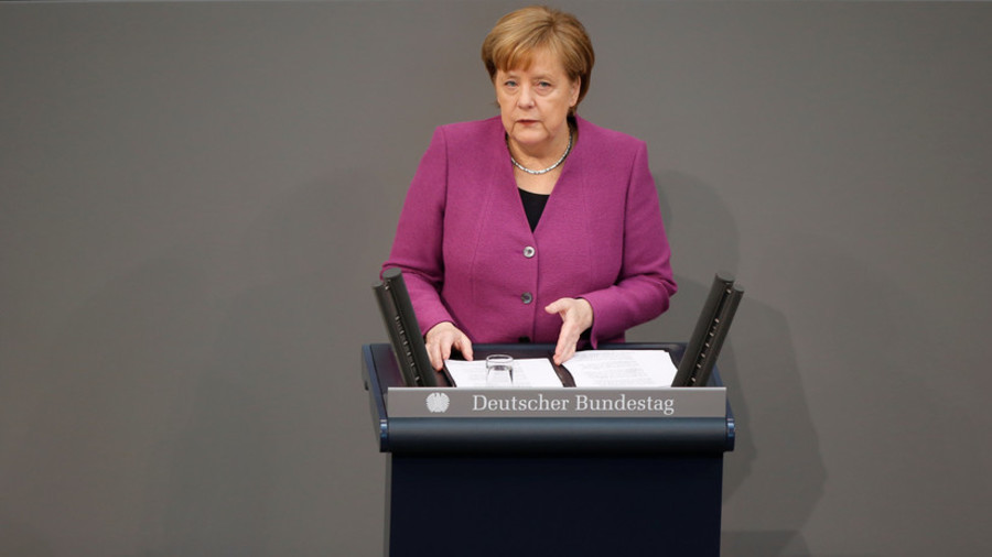 Merkel walks out of parliament after AfD leader lambasts her support for migrant quota system