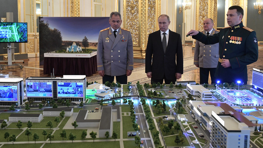 What's wrong with this picture? Putin scrutinizes scale model and...