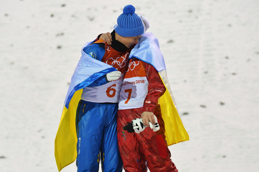 Olympic spirit: Ukrainian & Russian athletes embrace on Olympic podium