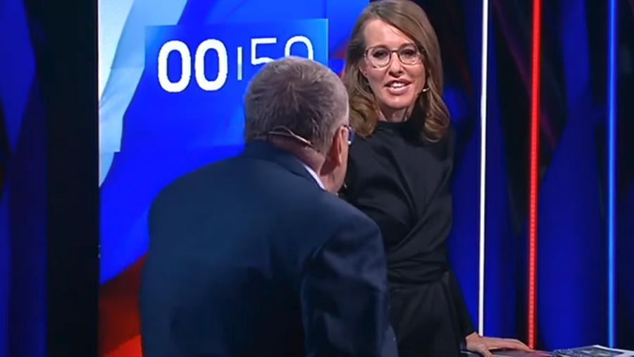 Slurs & water fly at Russian presidential debate as Lib Dem leader faces off with Sobchak