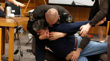 Eaton County Sheriffs restrain Randall Margraves after he lunged at Larry Nassar,during victim statements of his sentencing in the Eaton County Circuit Court in Charlotte © Rebecca Cook