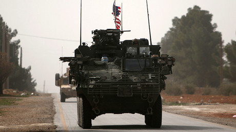 FILE PHOTO: American army vehicles drive north of Manbij city, in Aleppo Governorate, Syria March 9, 2017. © Rodi Said