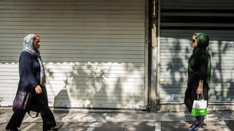 Iranian women walk on the sidewalk at Valiasr Square in Tehran on August 2, 2017. © Reuters