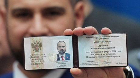 Maxim Suraikin, Russian presidential candidate from the Communists of Russia party, with his candidate ID after registering at the Russian Central Election Commission © Evgeny Biyatov