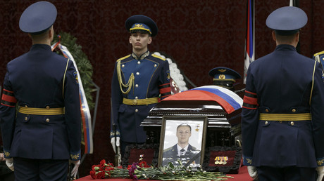 A portrait of pilot Roman Fillipov during a memorial service in Voronezh, Russia © Vadim Savitsky