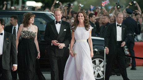 BAFTA Chief Executive Amanda Berry (2nd L), Britain's Prince William and his wife Catherine, Duchess of Cambridge, walk the red carpet as they arrive at the BAFTA Brits to Watch event in Los Angeles, California July 9, 2011.  ©
