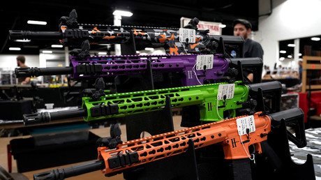 FILE PHOTO: AR-15 rifles with colored hand guards are displayed for sale at the Guntoberfest gun show in Oaks, Pennsylvania, U.S., October 6, 2017. © Joshua Roberts