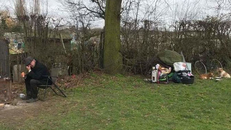 John Jones, 63, was pictured crying along with his two dogs and his possessions dumped on the ground after council evicted him from his own caravan.