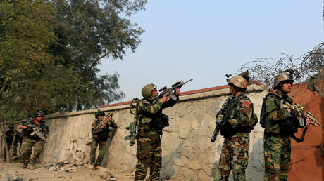 Afghan security forces take positions while responding to blasts and gunfire. January 24, 2018. © Parwiz
