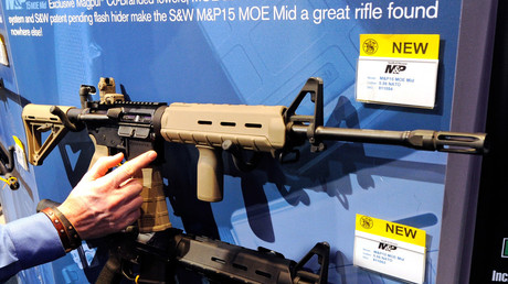 Smith & Wesson M&P15 MOE Mid rifles are displayed at the Smith & Wesson booth at the National Shooting Sports Foundation's 34th annual Shooting, Hunting, Outdoor Trade (SHOT). Ethan Miller
