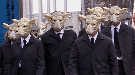 FILE PHOTO: Greenpeace activists protesting in sheep masks © Michael Dalder