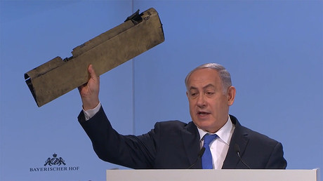 Netanyahu uses fragment of destroyed drone to taunt Iranian FM