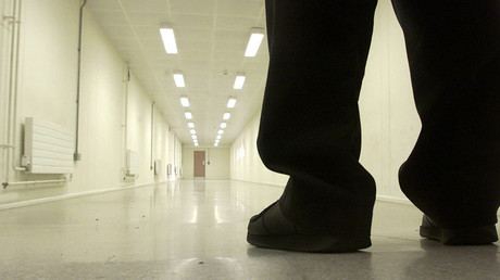 FILE PHOTO: A Group 4 security officer walks down one of the corridors of Yarl's Wood Immigration Removal Centre © Russell Boyce