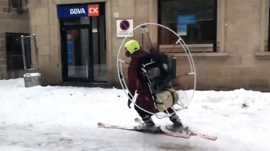 Paramotored skier takes to snowy Catalan streets as Europe is hit by freak blizzards (VIDEO)