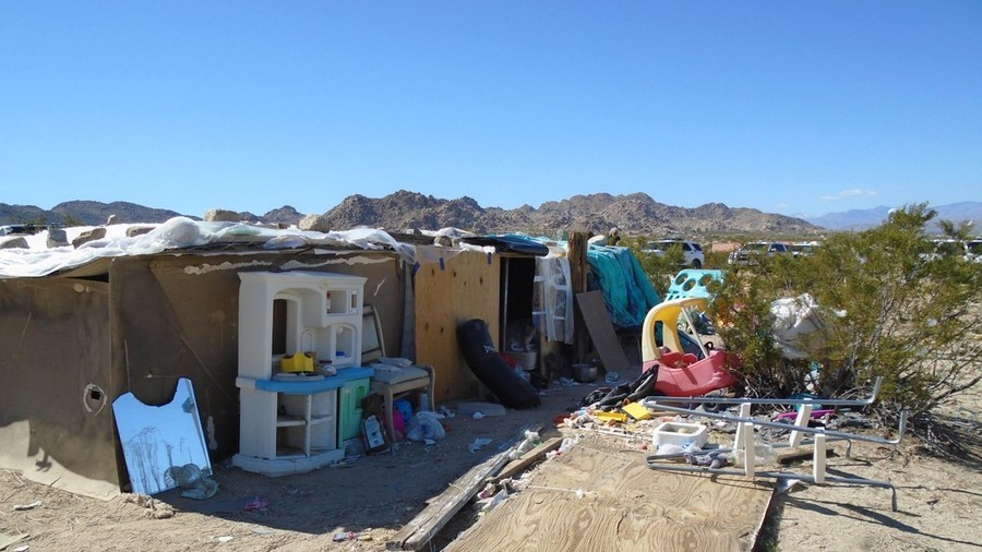 California couple arrested after police find children living in desert shelter