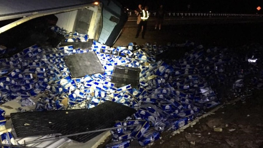 Truck carrying beer overturns on North Florida highway