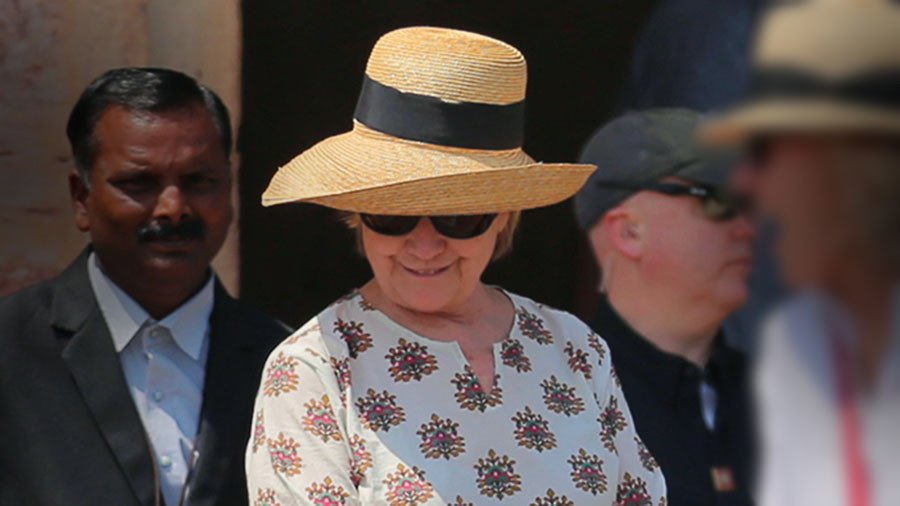 Hillary Nearly Falls Down Stairs Twice In India