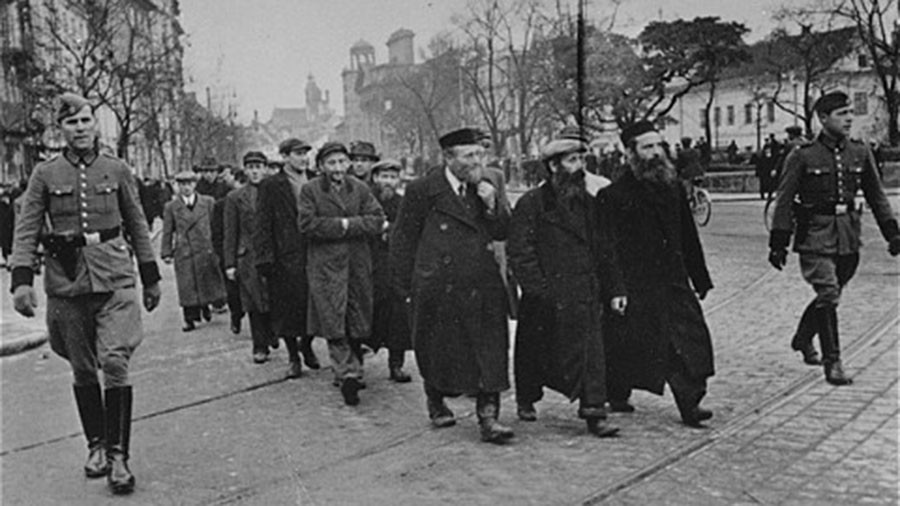 Jews moved to Warsaw Ghetto during WWII to avoid non-Jews & 'nasty Poles' – father of Polish PM
