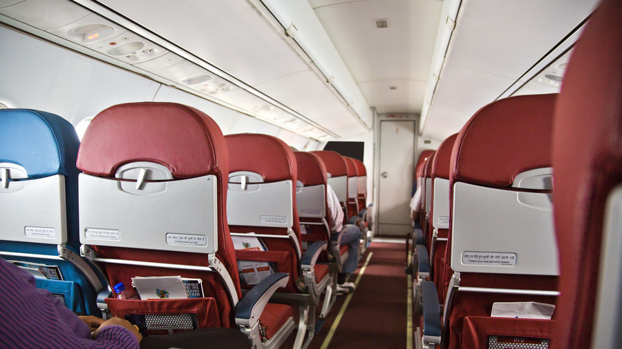 Sneeze on a plane: Where to sit to avoid catching pandemic influenza