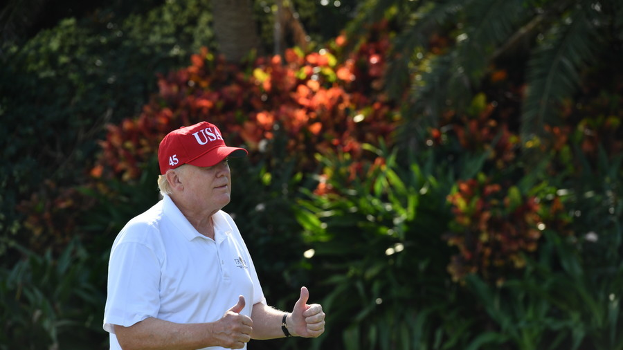Trump practices his golf swing as Americans march for gun control