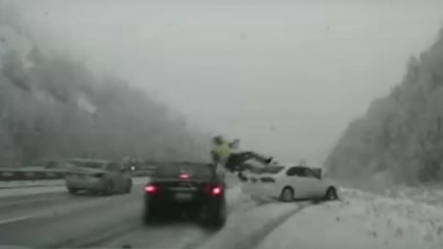 Dashcam captures officer's brush with death on snowy highway (GRAPHIC VIDEO)