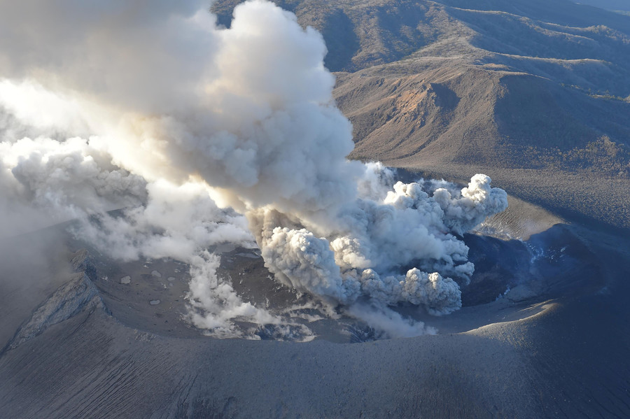 Japanese volcano erupts, grounding dozens of flights