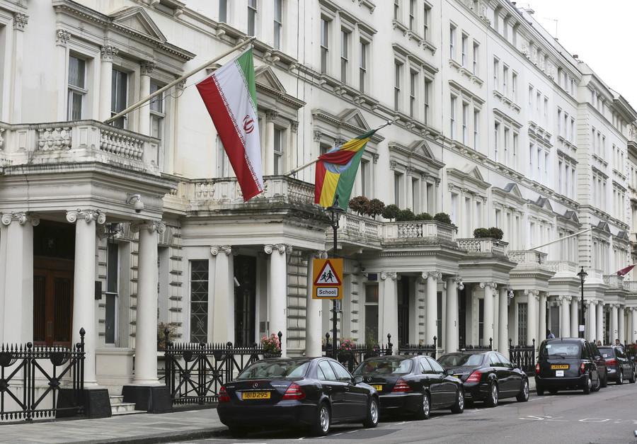 Men clad in black climb onto Iran's embassy in London, take down flag