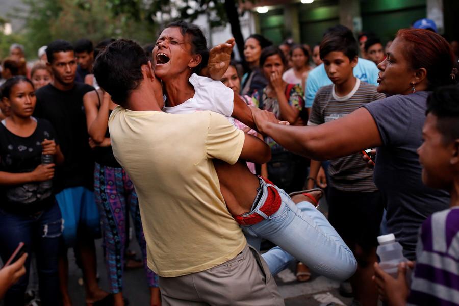 68 killed in Venezuela police station riot & fire