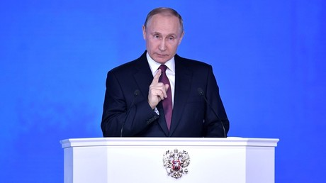Vladimir Putin delivering his annual address to the Federal Assembly on March 1, 2018
