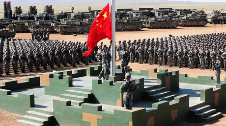 FILE PHOTO: Soldiers of China's People's Liberation Army (PLA) raise a Chinese national flag. © China Daily