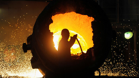 FILE PHOTO: A worker operates a furnace at a steel plant in Hefei, Anhui province August 18, 2013 © Jianan Yu