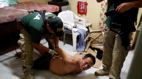 FILE PHOTO: Agents of the Philippine Drugs Enforcement Agency (PDEA) detain a drug trafficking suspect © Erik De Castro