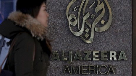 A woman passes by the Al Jazeera America broadcast center in New York City, January 13, 2016 © Brendan McDermid