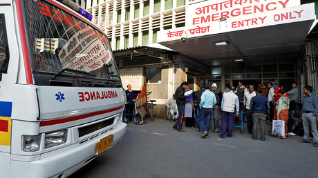 FILE PHOTO: An ambulance arrives as people stand at the entrance of the emergency department  © Saumya Khandelwal
