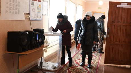 A woman takes part in the early voting at the Russian presidential election in a remote ethnic Tatar village of Kuskurgul in the Nizhnyaya Tavda district © Sergey Rusanov