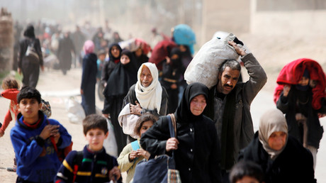 Over 30,000 leave militant-controlled E. Ghouta as people continue to flee for safety