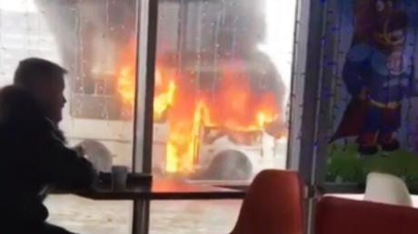 #ThisIsFine: Guy chows down while bus is engulfed in flames (VIDEO)