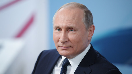 Vladimir Putin decisively re-elected as Russian president after 99% of votes counted