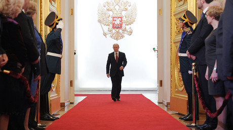 FILE PHOTO: President-elect Vladimir Putin(C), enters St Andrew Hall of the Grand Kremlin Palace during the inauguration ceremony © Alexei Druzhinin