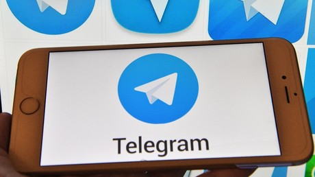 Telegram messenger logo on a computer and a smartphone © Natalia Seliverstova